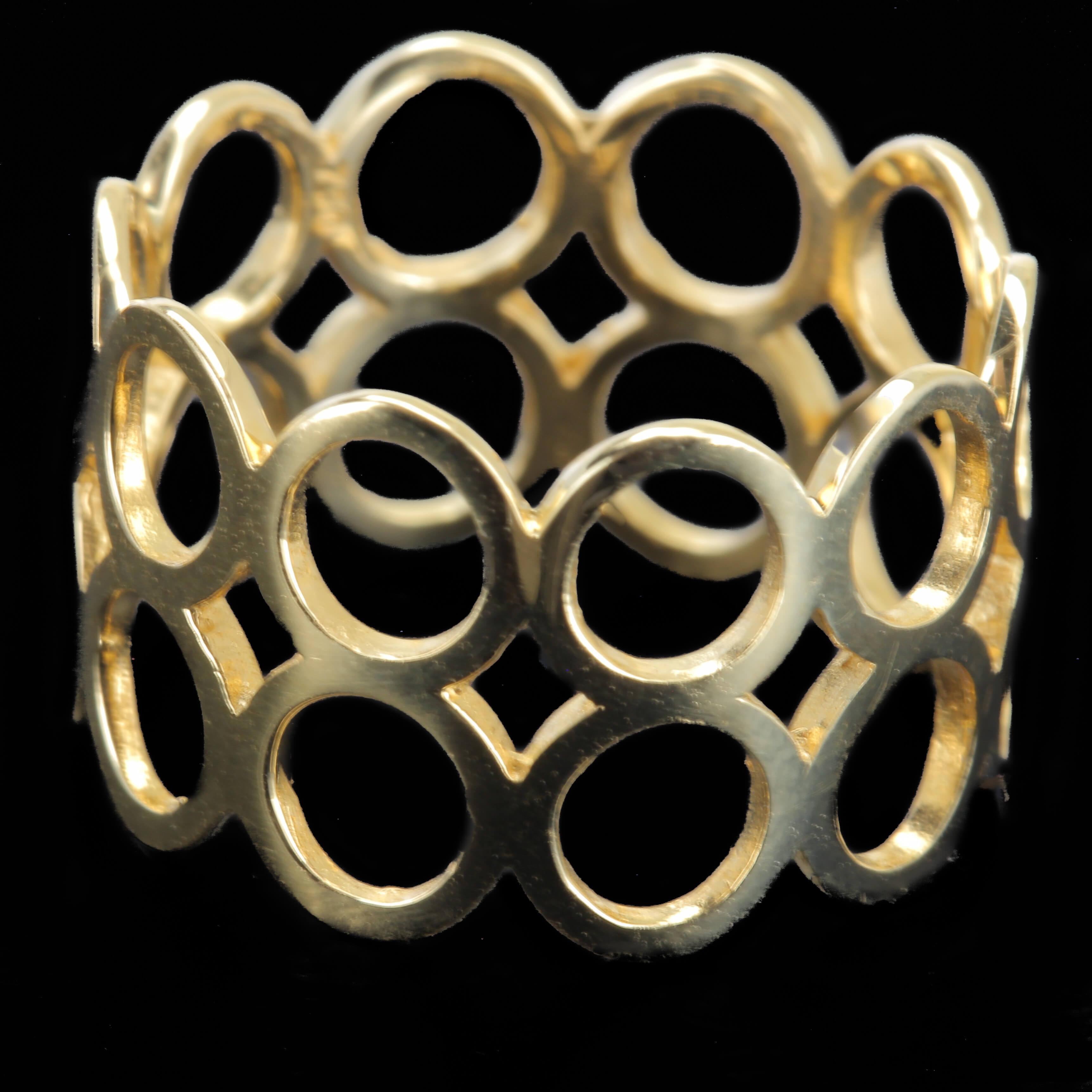 Gouden ring met cirkeltjes, 18Kt