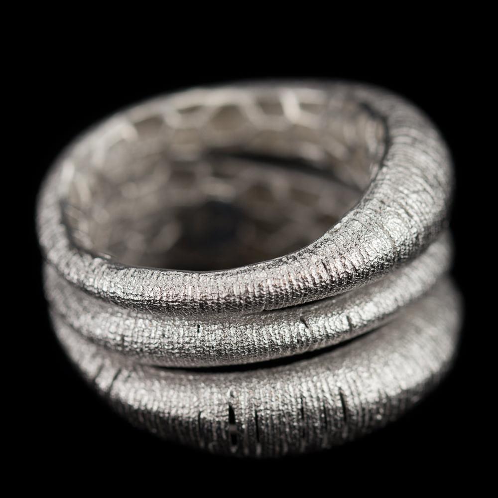 Brede drierijige zilveren ring