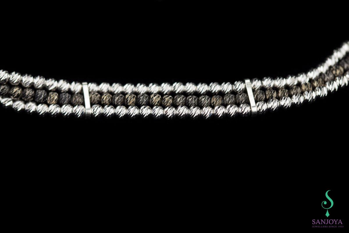Verfijnde armband van drie rijen zilver en zwart