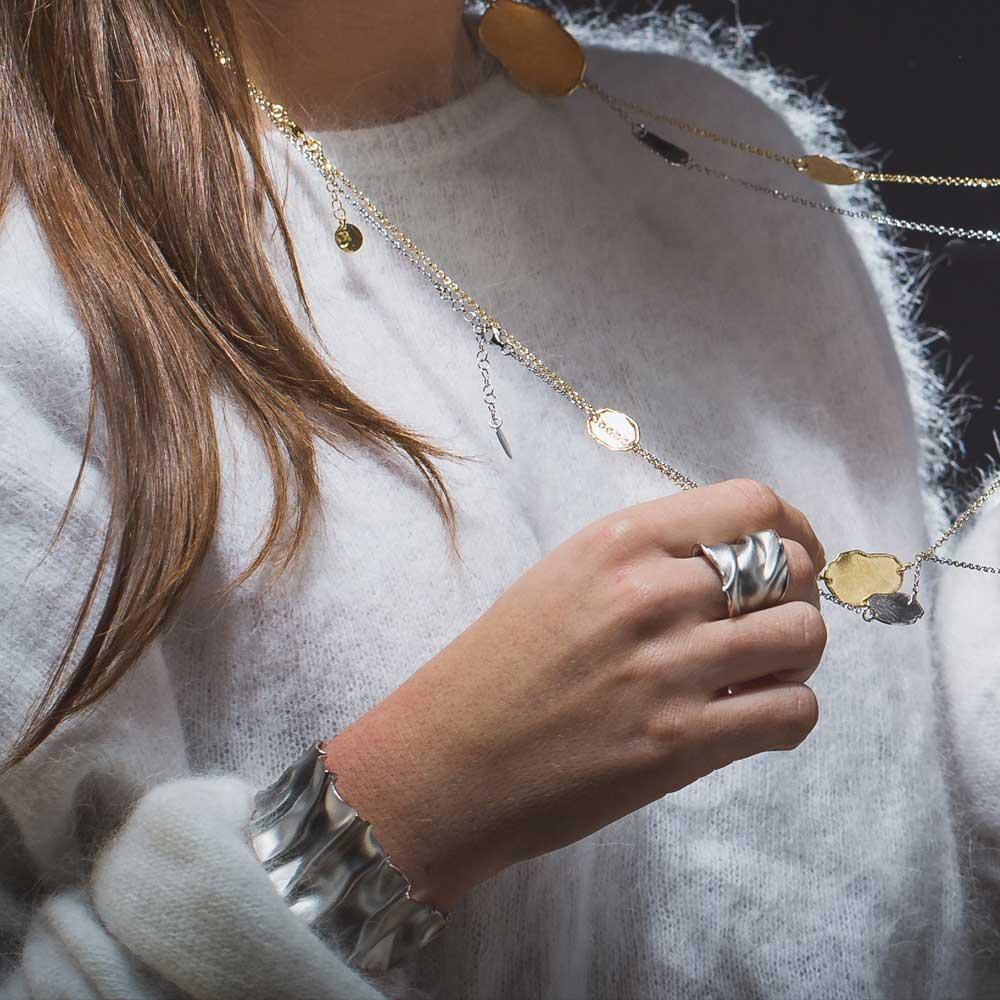 Matte plooiende en smallere armband van sterling zilver