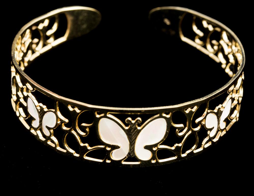 Vergulde slavenarmband vlinder en parelmoer
